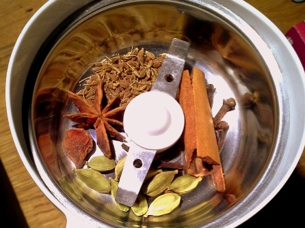 1 star anise, 8 cardamom pods, 6 peppercorns, half a cinnamon stick, a teaspoon of aniseed and six cloves in a spice grinder